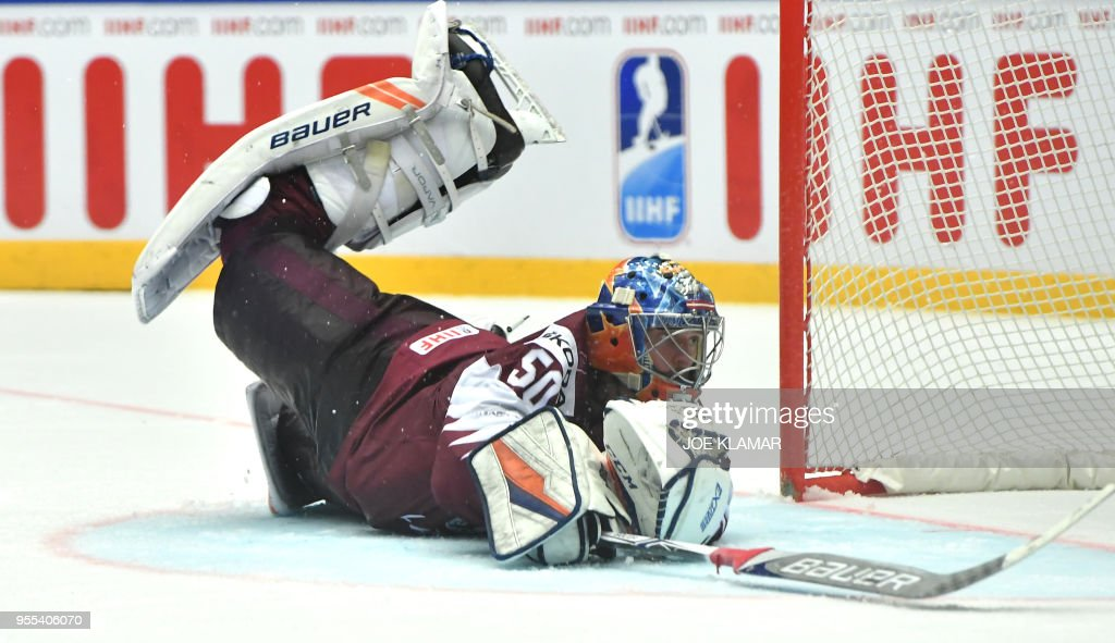 Latvia's goalkeeper Kristers Gudlevskis falls down after a puck during the group B match Latvia vs Finland of the 2018 IIHF Ice Hockey World Championship at the Jyske Bank Boxen in Herning, Denmark, on May 6, 2018.