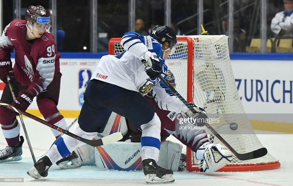 Latvia's goalkeeper Kristers Gudlevskis stops Finland's Mikael Granlund (R) during the group B match Latvia vs Finland of the 2018 IIHF Ice Hockey World Championship at the Jyske Bank Boxen in Herning, Denmark, on May 6, 2018.