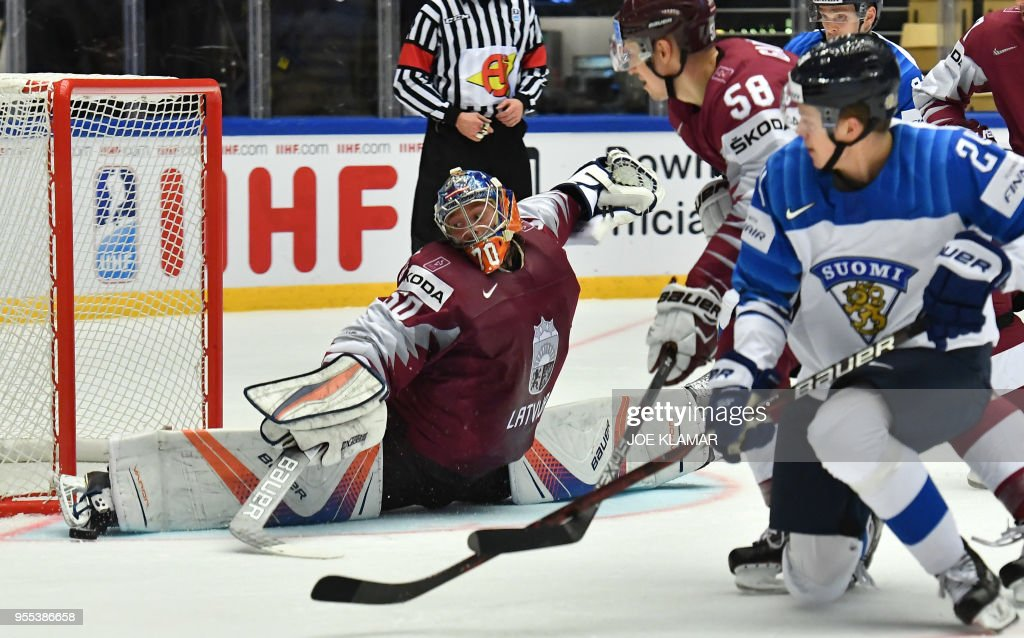 Latvia's goalkeeper Kristers Gudlevskis stops the puck during the group B match Latvia vs Finland of the 2018 IIHF Ice Hockey World Championship at the Jyske Bank Boxen in Herning, Denmark, on May 6, 2018.