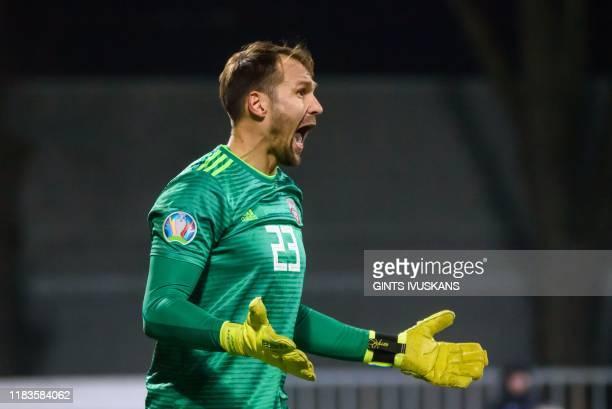 Latvia's goalkeeper Pavels Steinbors reatcs during the UEFA Euro 2020 Group G qualification football match Latvia v Austria in Riga Latvia on...