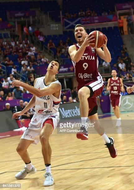 Latvia's guard Dairis Bertans vies for the ball with Serbia's forward Vladimir Lucic during the FIBA Eurobasket 2017 men's group D basketball match...