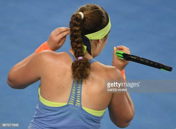 Latvia's Jelena Ostapenko adjusts her hair as she prapares to serve to Estonia's Anett Kontaveit during their women's singles third round match on...