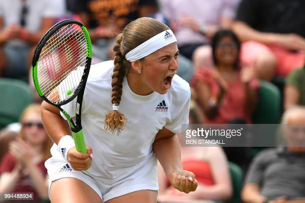 Latvia's Jelena Ostapenko celebrates a point against Belarus' Aliaksandra Sasnovich in their women's singles fourth round match on the seventh day of...