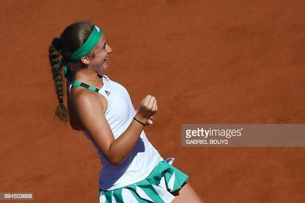 Latvia's Jelena Ostapenko celebrates winning against Romania's Simona Halep during their final tennis match at the Roland Garros 2017 French Open on...