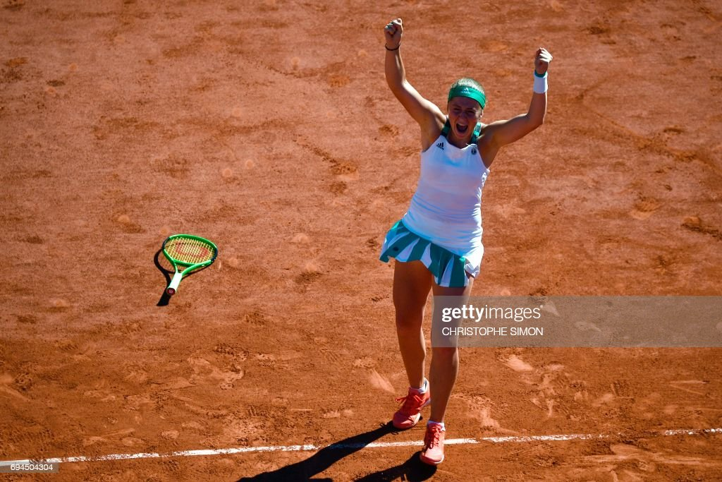 TOPSHOT - Latvia's Jelena Ostapenko celebrates winning against Romania's Simona Halep during their final tennis match at the Roland Garros 2017 French Open on June 10, 2017 in Paris. /