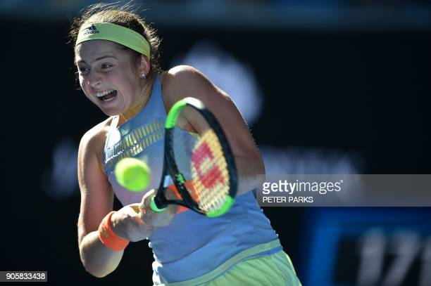 Latvia's Jelena Ostapenko hits a return against China's Duan YingYing during their women's singles second round match on day three of the Australian...