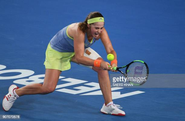 Latvia's Jelena Ostapenko plays a backhand return to Estonia's Anett Kontaveit during their women's singles third round match on day five of the...