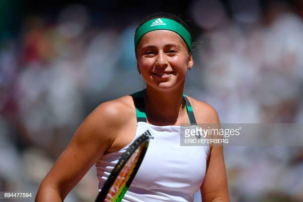 Latvia's Jelena Ostapenko reacts after a point against Romania's Simona Halep during their final tennis match at the Roland Garros 2017 French Open...
