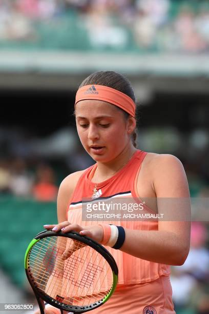 Latvia's Jelena Ostapenko reacts during her women's singles first round tennis match against Ukraine's Kateryna Kozlova on day one of The Roland...