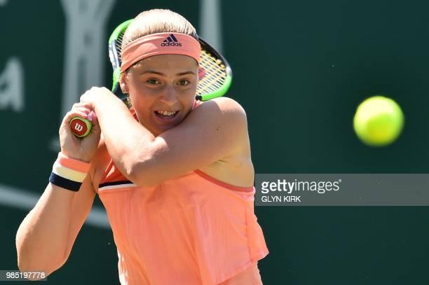 Latvia's Jelena Ostapenko returns against Romania's Mihaela Buzarnescu during their Women's singles third round match at the ATP Nature Valley...