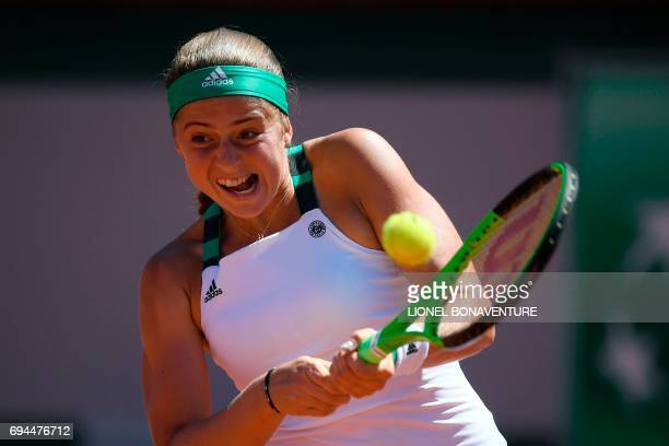 Latvia's Jelena Ostapenko returns the ball to Romania's Simona Halep during their final tennis match at the Roland Garros 2017 French Open on June...
