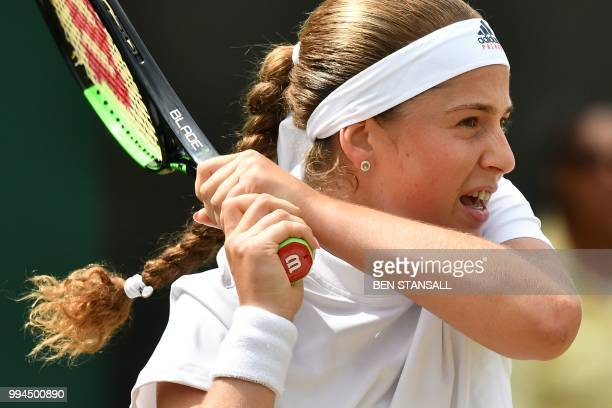 Latvia's Jelena Ostapenko returns to Belarus' Aliaksandra Sasnovich in their women's singles fourth round match on the seventh day of the 2018...
