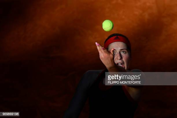TOPSHOT Latvia's Jelena Ostapenko serves against Russia's Maria Sharapova during their quarter final match at Rome's WTA Tennis Open tournament at...