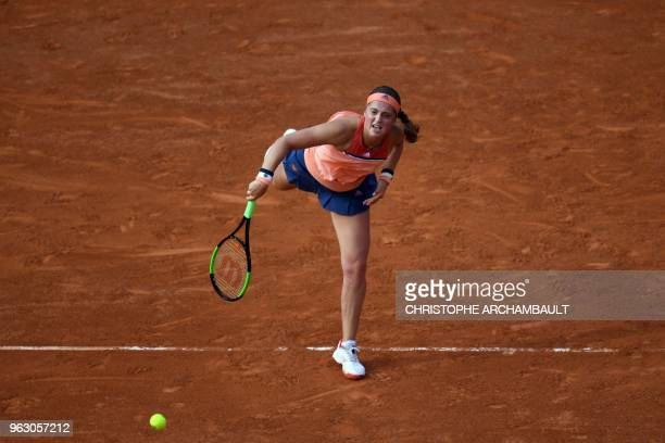 Latvia's Jelena Ostapenko serves the ball to Ukraine's Kateryna Kozlova during their women's singles first round match on day one of The Roland...