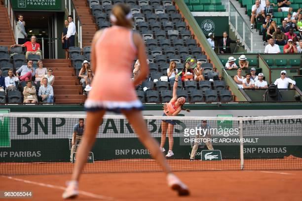 Latvia's Jelena Ostapenko serves the ball to Ukraine's Kateryna Kozlova during their women's singles first round tennis match on day one of The...