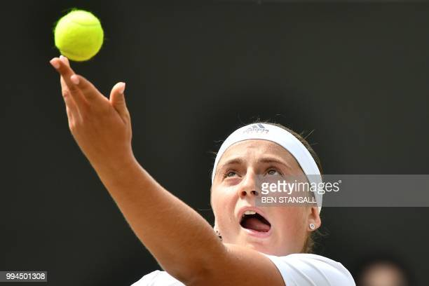 Latvia's Jelena Ostapenko serves to Belarus' Aliaksandra Sasnovich in their women's singles fourth round match on the seventh day of the 2018...