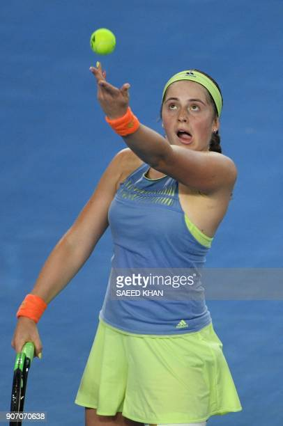 Latvia's Jelena Ostapenko serves to Estonia's Anett Kontaveit during their women's singles third round match on day five of the Australian Open...