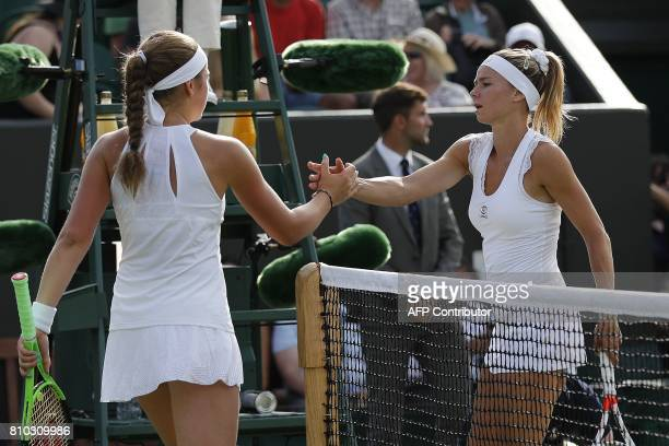 Latvia's Jelena Ostapenko shakes hands with Italy's Camila Giorgi after winning their women's singles third round match on the fifth day of the 2017...