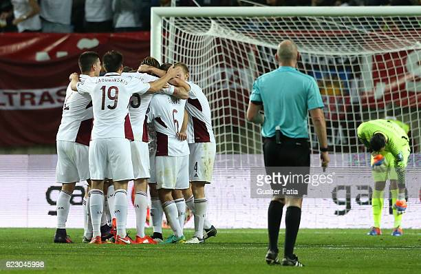 Latvia's midfielder Arturs Zjuzins from Latvia celebrates with teammates after scoring a goal during the FIFA 2018 World Cup Qualifier match between...