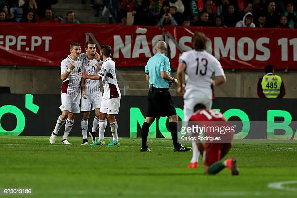 Latvia's midfielder Arturs Zjuzins from Latvia celebrates with his team mates scores Latvia goal during the Portugal v Latvia FIFA 2018 World Cup...