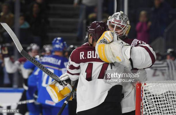 Latvia´s players celebrate during the IIHF Ice Hockey World Championships first round match between Italy and Latvia in Cologne western Germany on...