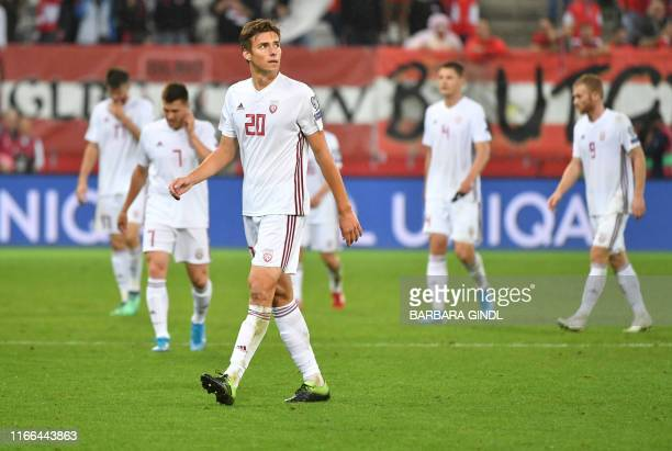Latvia's players react after the UEFA Euro 2020 qualification football match between Austria and Latvia in Salzburg Austria on September 6 2019 /...