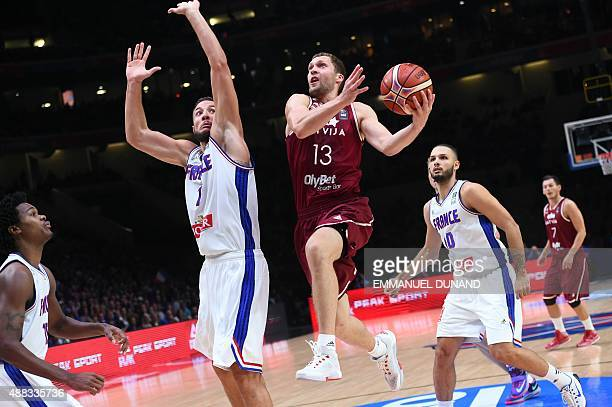 Latvia's point guard Janis Strelnieks goes to the basket during the round of 8 basketball match between France and Latvia at the EuroBasket 2015 in...
