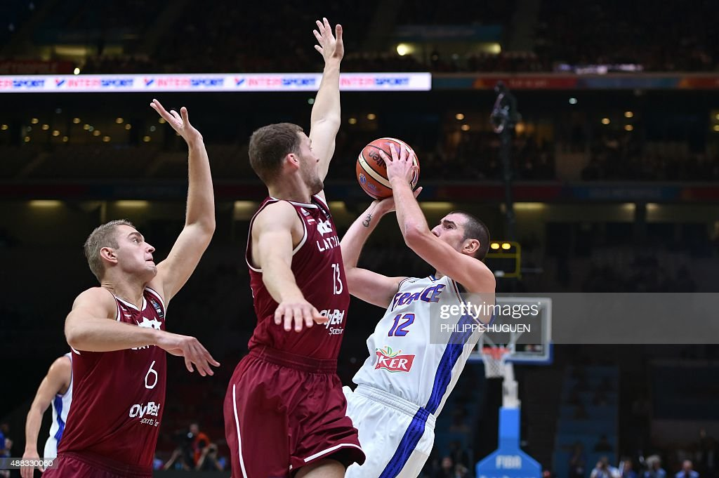 latvia s power forward rolands freimanis l and latvia s point