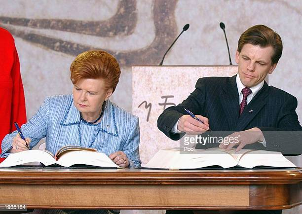 Latvia's President Vaira VikeFreiberga left and Prime Minister Einars Repse sign their Accession Treaty April 16 2003 at Agora's Stoa of Attalos in...