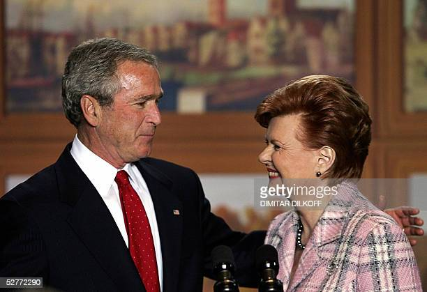 Latvia's President Vaira VikeFreiberga smiles with US President George W Bush after his speech at the Maza Gilde in Riga 07 May 2005 The occupation...