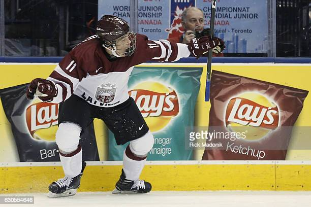 Latvia's Renars Krastenbergs begins his celebration after scoring Team USA vs Team Latvia in 1st round action of 2017 IIHF Junior championship...