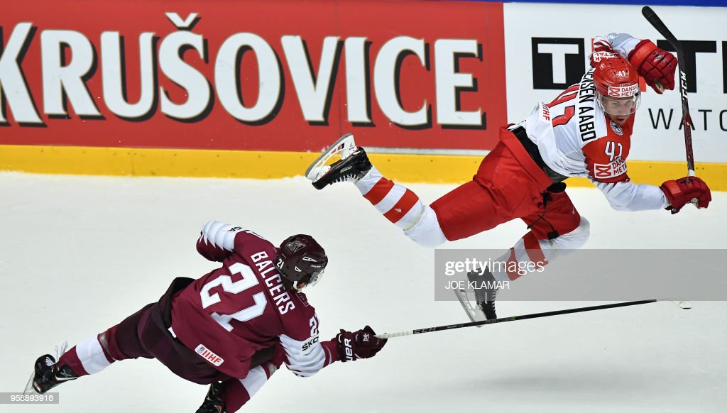 Latvia's Rudolfs Balcers (L) is fouled by Denmark's Jesper Jensen Aabo during the group B match Latvia v Denmark of the 2018 IIHF Ice Hockey World Championship at the Jyske Bank Boxen in Herning, Denmark, on May 15, 2018.