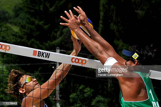 Latvia's Ruslans Sorokins and Brazil's Ricardo Santos clash RicardoÁlvaro Filho v SorokinsSmedins T game as part of the FIVB Gstaad Grand Slam third...