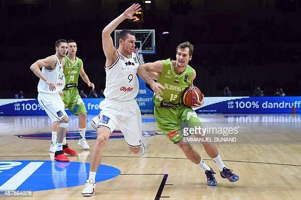 Latvia's shooting guard Dairis Bertans defends against Slovenia's small forward Zoran Dragic during the round of 16 basketball match between Latvia...