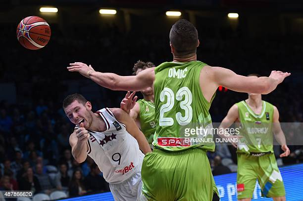 Latvia's shooting guard Dairis Bertans misses the ball during the round of 16 basketball match between Latvia and Slovenia at the EuroBasket 2015 in...