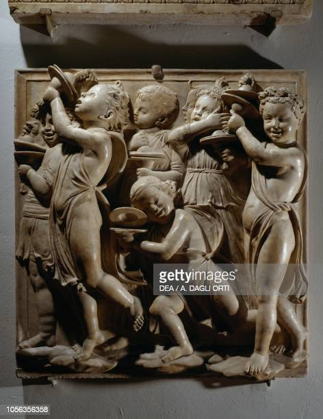 Laudate Eum in cimbalis iubilationis panel with cymbal players 14311438 marble basrelief detail of the Cantoria by Luca della Robbia Cathedral of...