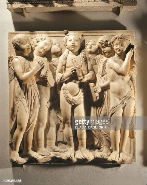 Laudate Eum in cymbalis bene sonantibus panel with putti and angels playing cymbal 14311438 marble basrelief detail of the Cantoria by Luca della...