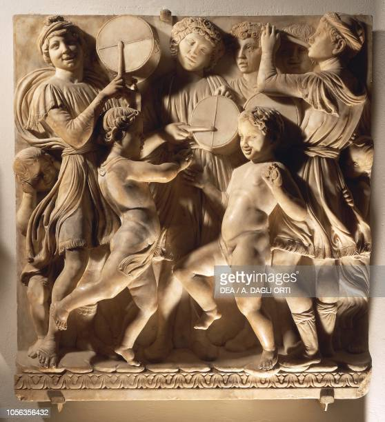 Laudate Eum in timpano panel with drummers 14311438 marble basrelief detail of the Cantoria by Luca della Robbia Cathedral of Santa Maria del Fiore...