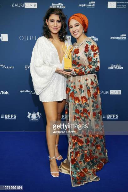 """Laudator Almila Bagriacik and Tua El-Fawwal, winner of the award in the category """"Nachwuchs"""", poses at the Deutscher Schauspielpreis 2020 at Spindler..."""