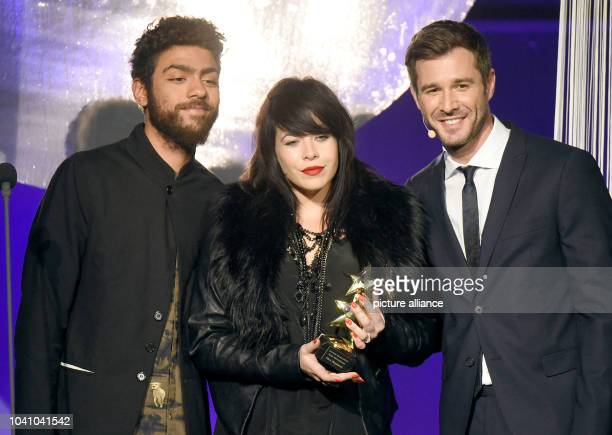 Laudator Noah Becker British singer and awardee Alex Hepburn in the category 'Music International 2014' and presenter Jochen Schropp during the event...