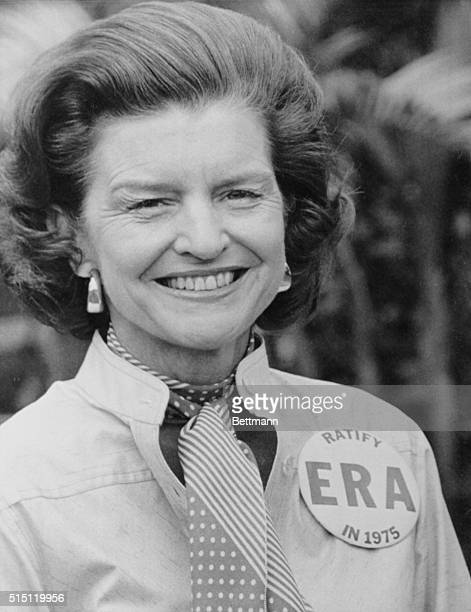 """Lauderhill, Florida: First Lady Betty Ford shows off the """"ERA"""" button given her while her husband plays golf, February 26. Mrs. Ford has expressed..."""