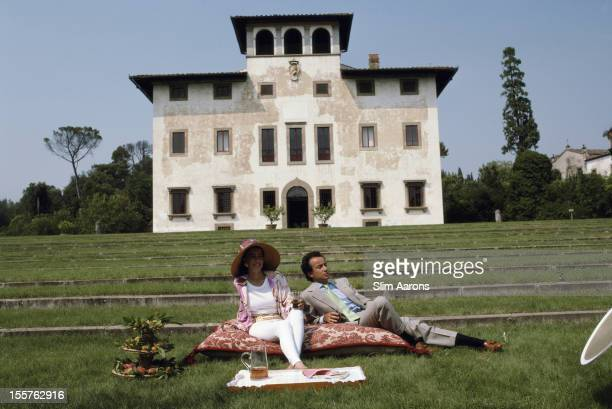 Laudomia Pucci di Barsento and her brother Marchese Alessandro Pucci di Barsento relaxing in the grounds of their estate in the hills of Florence...