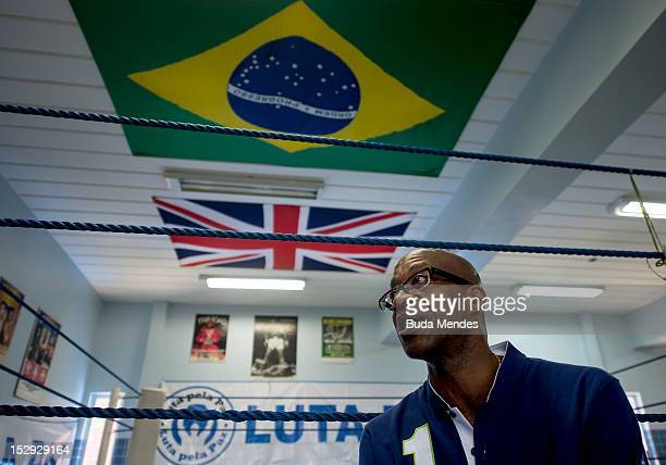 Lauerus Ambassador and former athlete Edwin Moses poses for a picture during an official visit to Luta Pela Paz Project at Complexo da Mare on...