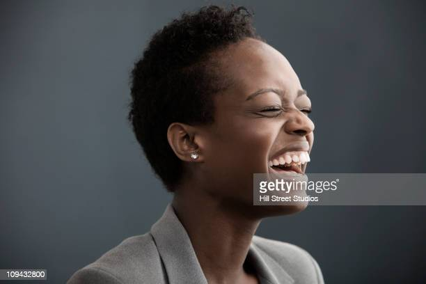 Laughing African American businesswoman