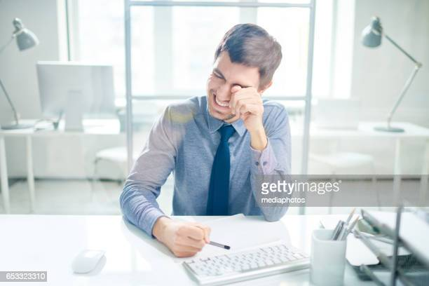 Laughing and crying businessman