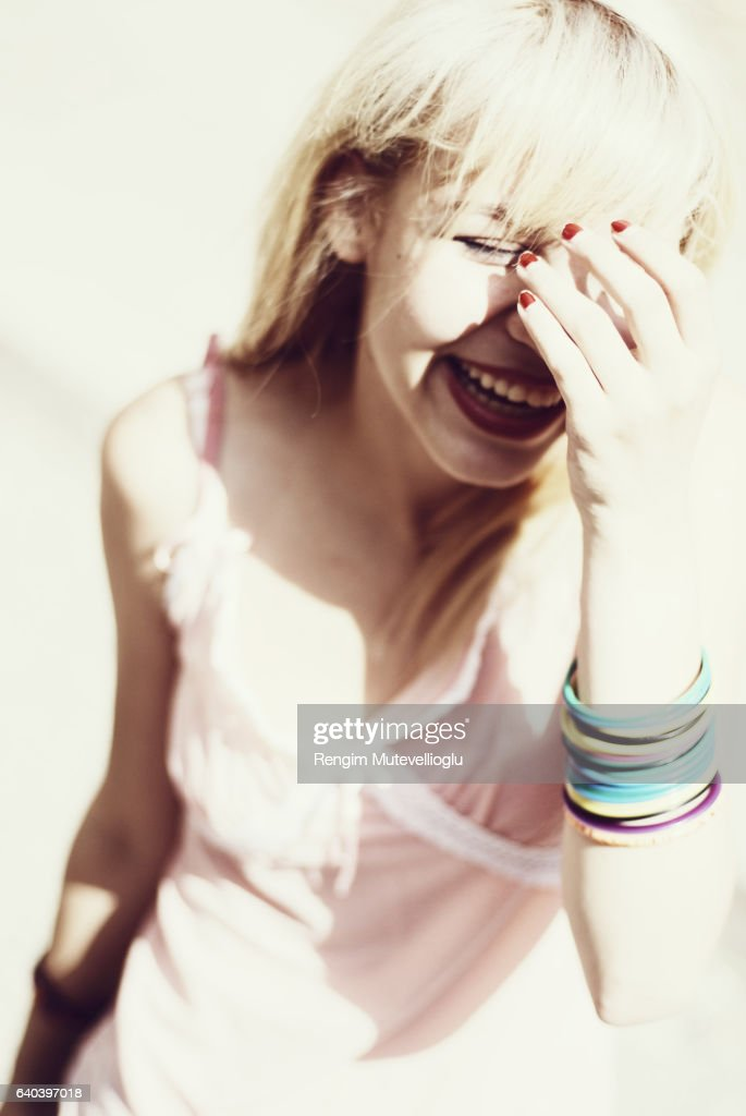 Laughing and hiding her face : Stock Photo