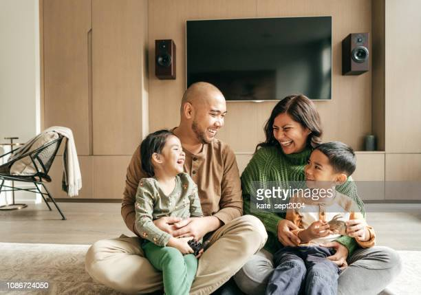 laughing as we are happy family and its fun sunday - home insurance stock pictures, royalty-free photos & images