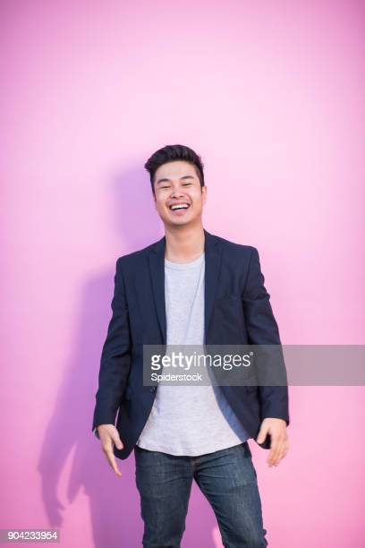 laughing asian young adult hipster - coloured background stock pictures, royalty-free photos & images