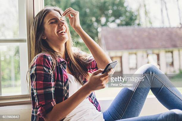 Laughing at a funny message