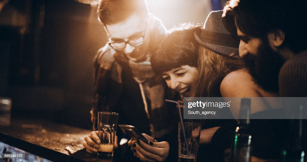 Laughing at the photo : Stock Photo